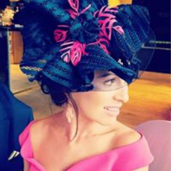 Custom made bespoke gathered crinoline and navy striped material with fuschia pink feather centre. Wedding guest or ladies day attendee. Racing fashion.