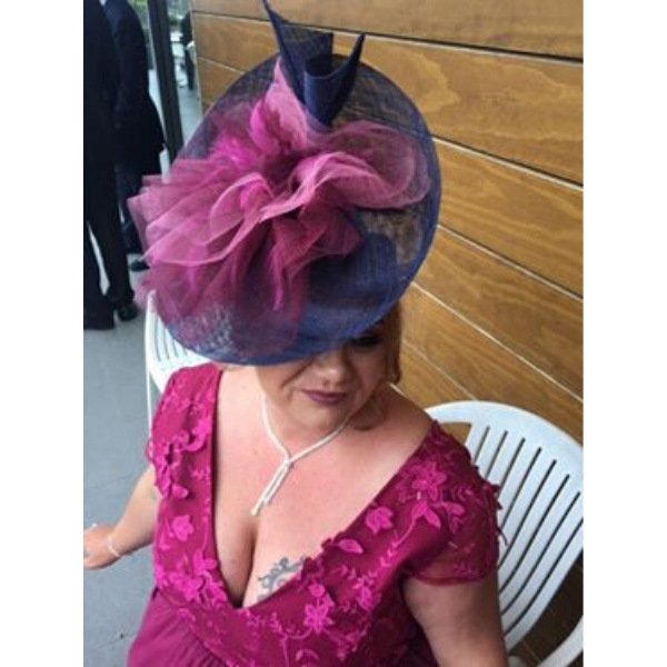 Navy Sinamay bespoke designed hat with raspberry tuille trimming for wedding guest, mother of the bride, mother of the groom and Ladies day attendees for day at the races hat