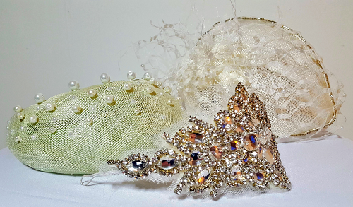 Crystal applique bridal headpiece in more detail in forgound of various other bridal headpieces