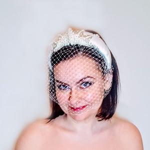 Bridal satin and beaded Headband model looking forward and smiling