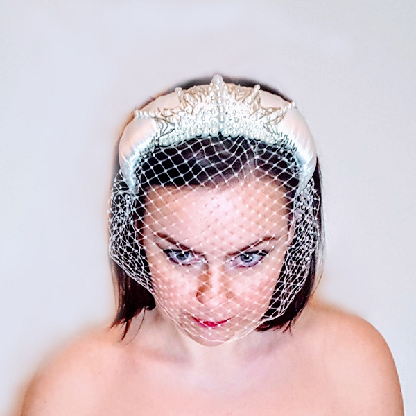 Bridal satin and beaded Headband model looking head down and eyes in front