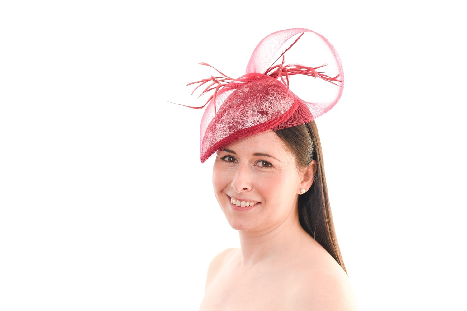 Claret Wine Cocktail Hat on models right side of head with model looking direct at camera and smiling