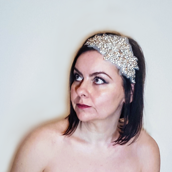 Crystal applique bridal headpiece looking up to the left small