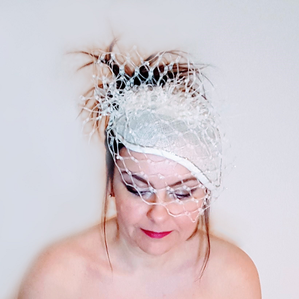 Ivory pearl veiled bridal millinery looking down small