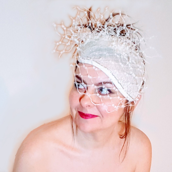 Ivory pearl veiled bridal millinery looking up to left small