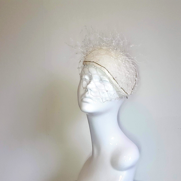 Ivory veiled bridal millinery on mannequin head.small
